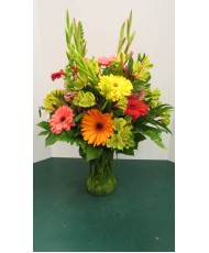 Vase Arrangement with Yellows, Oranges, Reds and Green