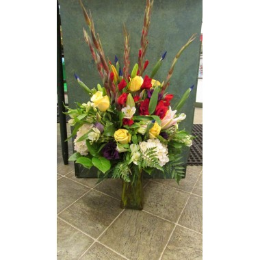 Vase Arrangements with Red gladiolas, yellows and blues