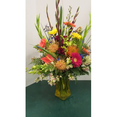 Vase Arrangement with Purples, Oranges, Blues and Yellows