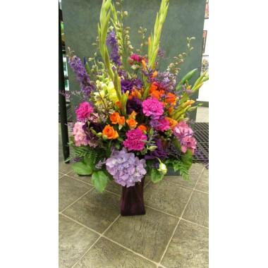 Vase Arrangement with oranges, hot pinks